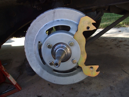 New Right Front Disc Brake Shield And Caliper Adapter Plate Installed On Spindle