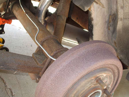 Old_Stock_Rear_Shock_And_Leaf_Spring_Right_Side_Front_View