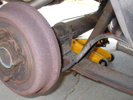 Old_Stock_Rear_Shock_And_Leaf_Spring_Right_Side_Rear_View